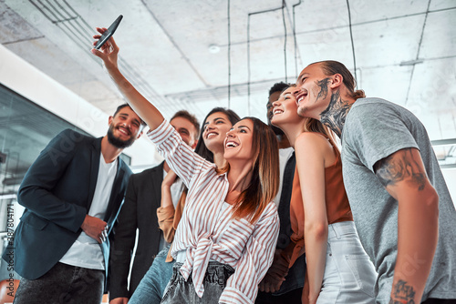 Obraz na plátne Business people taking selfie of themselves in the office