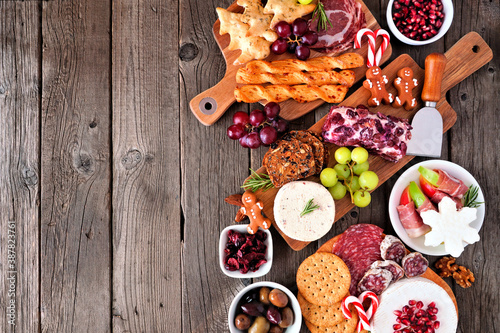 Fotografering Christmas theme charcuterie side border against a dark wood background
