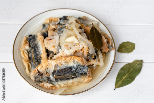 Papel de parede Fried herring in a vinegar marinade with a bay leaf, mustard and allspice