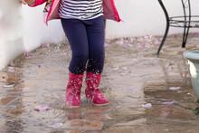 Little Girl Splashing In The P...