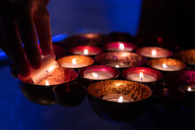 Lighting A Candle On A Large, ...