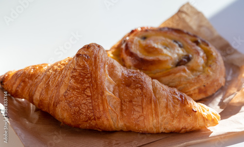 Fototapeta French breakfast in bakery served outdoor, fresh baked croissants and sweet past