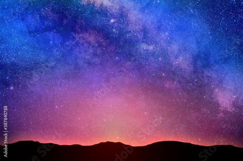 Foto Night sky. Starry sky over the horizon