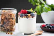 Yogurt Granola Parfait With Berries. Greek Yogurt With Oat Honey Granola, Raspberries And Blueberries In A Jar