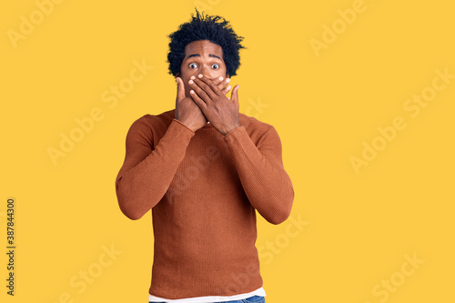 Handsome african american man with afro hair wearing casual clothes shocked covering mouth with hands for mistake Poster Mural XXL