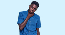 Young African American Man Wearing Casual Clothes Touching Painful Neck, Sore Throat For Flu, Clod And Infection