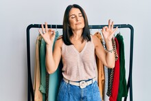 Middle Age Brunette Woman Working As Professional Personal Shopper Relax And Smiling With Eyes Closed Doing Meditation Gesture With Fingers. Yoga Concept.