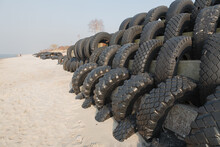 Blocks Of Old Tires. Their Reuse Protects The Seaside. Sunny Seascape.