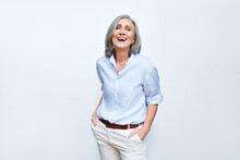 Happy Elegant Mature Senior Business Woman Laughing Standing Isolated On Grey Background. Smiling Confident Cheerful Middle Aged 60s Lady With Dental White Smile Looking At Camera, Copy Space.