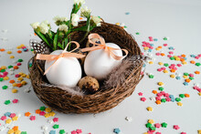 Happy Easter Postcard. Easter Eggs With Ribbons In The Nest.