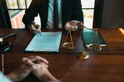 Fotografie, Obraz Business lawyer is currently counseling the client's trial at the lawyer office