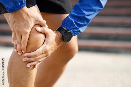 Fotografija Runner touching painful twisted or broken