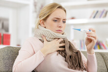 Exhausted Woman Having Fever A...