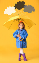Cute Little Girl In Raincoat And With Umbrella Under Drawn Cloudy Sky On Color Background