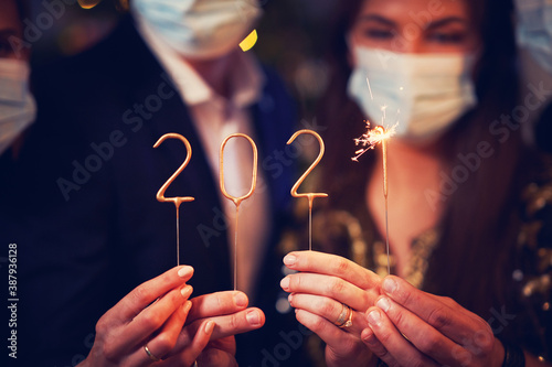 Fotografia, Obraz Two beautiful young couples having fun at New Year's Eve Party