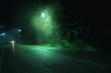Street Light With Smoke On Roadside Near Abandoned House