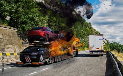 Slika na platnu The truck carrying cars caught fire. Trailer carrying cars. Fire
