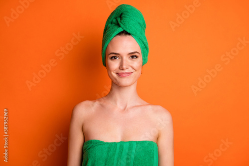 Valokuvatapetti Photo of young charming lady after shower look camera wear green towel turban is