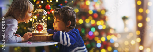 Fotografie, Obraz children on christmas eve in bright decorations