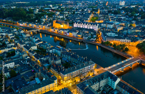 Obraz Evening aerial view of Laval with buildings, river Mayenne and old bridge, Mayenne department, north-western France - fototapety do salonu
