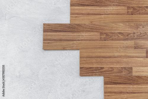 Fototapeta Wooden flooring installation and renovation, with base cement floor obraz na płótnie