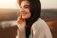 Happy Young Woman Enjoying Sun...