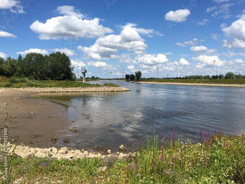 Beach at waterway river in Zupthen, the Netherlands Fotobehang