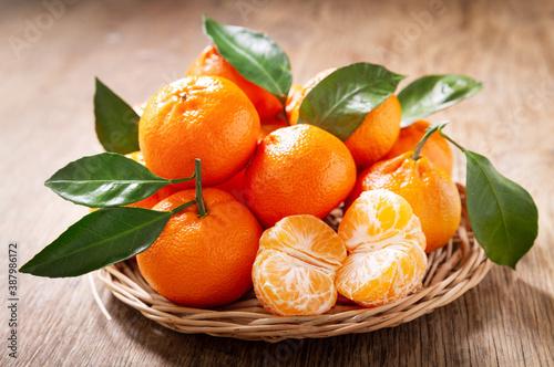 Vászonkép Fresh mandarin oranges fruit or tangerines with leaves
