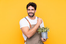 Gardener Man With Beard Over Isolated Yellow Background Celebrating A Victory