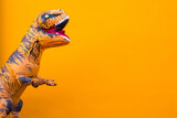 one big and tall dinosaur enjoying and having fun with orange background - copy and blank space to write your text here