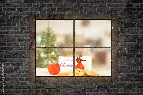 milk and biscuits prepared for the arrival of santa on a table Canvas