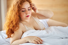 Sensual Woman With Red Hair An...