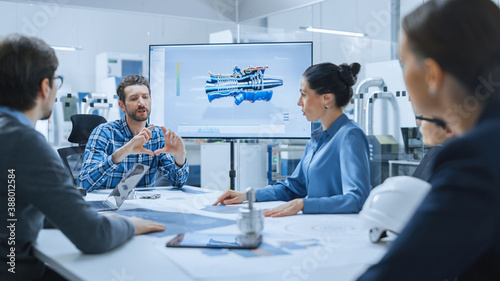 Fototapety, obrazy: Modern Factory Office Meeting Room: Diverse Team of Engineers, Managers and Investors Talking at Conference Table, Use Interactive TV, Analyze Sustainable Energy Engine Blueprints. High-Tech Facility