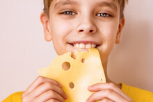 Boy Biting A Piece Of Cheese P...