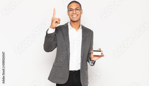 young black man feeling like a happy and excited genius after realizing an idea, Billede på lærred