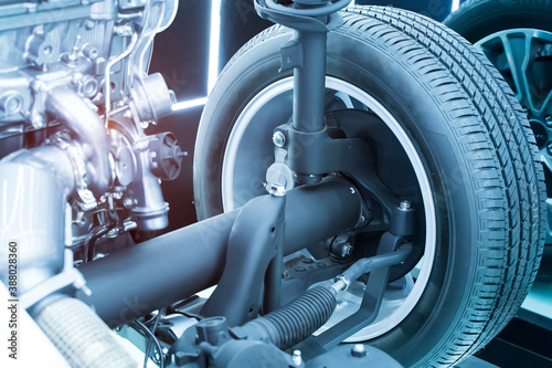 Obraz electric system of eco car front driving axle in the car, visible elements of the steering system - fototapety do salonu