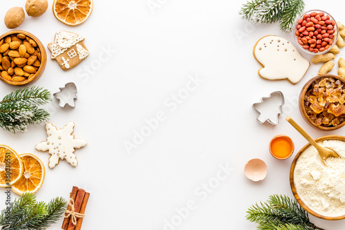 Obraz na plátně Christmas cooking background with gingerbread cookies, overhead view, flat lay