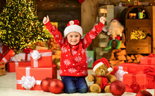Cherished Dreams. Happy Childhood. Winter Holidays. Playful Baby Boy. Happy Child Celebrate New Year. Little Boy Play Near Christmas Tree. Christmas Eve. Kid Fun Home. Merry Christmas Everyone