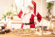Santa Claus Making Italian Pizza In Kitchen.