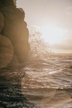 Waves Crashing Against Cliff