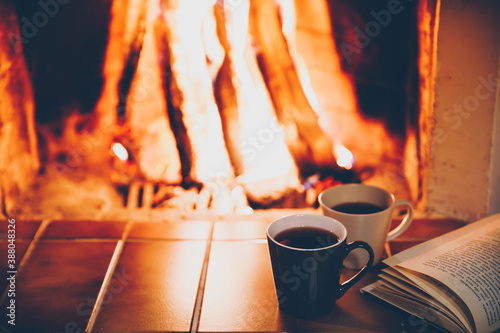 Cuadros en Lienzo Two cups and Open book by Fireplace