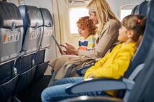 Woman Inside A Plane Showing A...