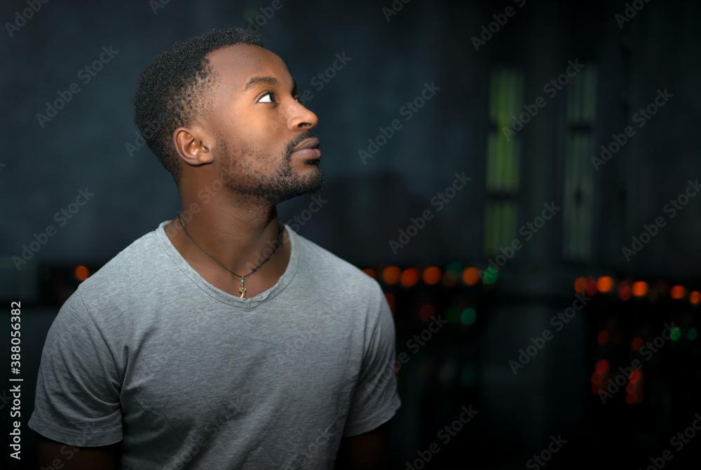 Fototapeta dark studio portrait young man profile view looking up