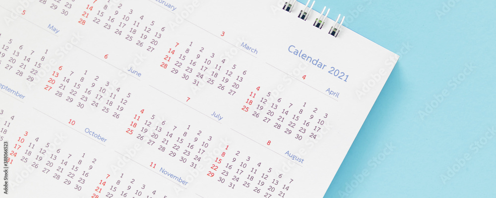 Fototapeta 2021 calendar page on blue background business planning appointment meeting concept