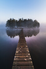 Wooden Bridge On Little Island In Fog