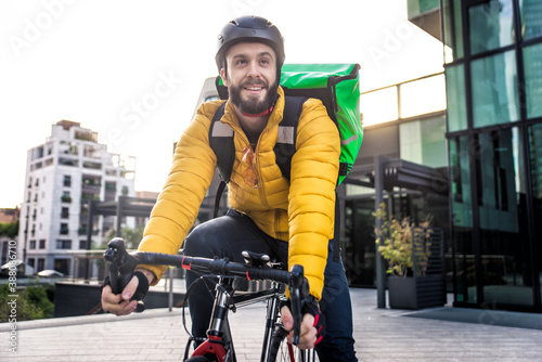 Fotografia Food delivery rider on his bicycle.