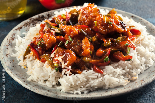 Fotografia Sweet and sour chicken with colorful bell pepper with rice