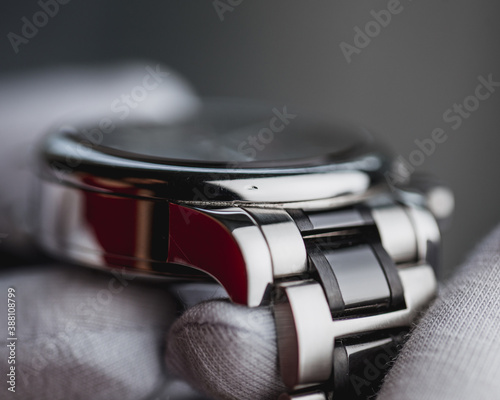 Fotografie, Obraz The nick on the watch case is a dent in the polished chrome