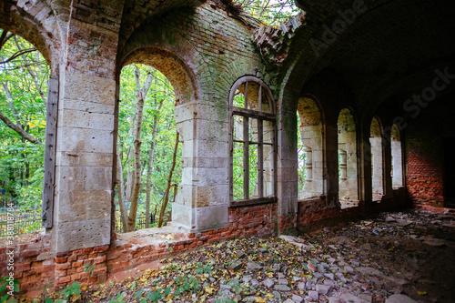 Dark corridor of old ancient abandoned red brick ruined historical building Fototapet