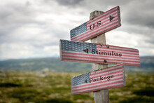 Us Stimulus Package Text On Signpost With The American National Flag.